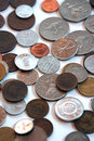 Scattered old foreign coins Royalty Free Stock Photo