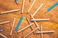 Scattered pencils on rustic wooden table Royalty Free Stock Photo