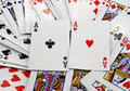 Scattered playing cards face up background Royalty Free Stock Photo