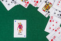 Scattered playing cards with the joker Royalty Free Stock Photo