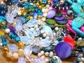 Scattering beads of semiprecious stones lapis lazuli turquoise moonstone pearl rhinestone Royalty Free Stock Photography