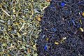 Scattering of black and green tea. Close-up Royalty Free Stock Photography