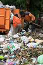 Scavenger sorting garbage in landfills in the city of solo central java indonesia Royalty Free Stock Images