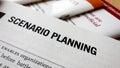 Scenario planning word on a book business success concept Stock Photos