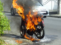 Scene of civil war motorbike burning at the corner the road Stock Photos