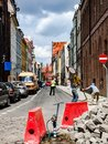 Road works on narrow street in old part of the Torun city in Poland.