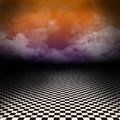 Scenery with black and white checker floor and colorful clouds