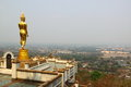Scenery view golden buddha the landmark of wiang sa city nan thailand Stock Photo