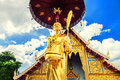 Scenery view golden Buddhist monk statue in Buddha Thailand Temple Royalty Free Stock Photo