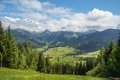 Scenery view in maria alm from the mountain to the valley austrian with green grass blue sky and snow Royalty Free Stock Photography