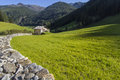 Scenic alpine meadow, hut an mountains Stock Photos
