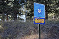 Scenic byway lariat loop signs golden co usa november yellow white and blue flower and red lettering on the hill side of a road Stock Photography