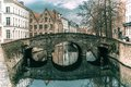 Scenic city view of Bruges canal and bridge Royalty Free Stock Photo