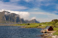 Scenic fjord on Lofoten islands with typical fishing hut Royalty Free Stock Photo