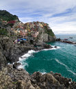 Scenic italian town of manarola quaint buildings on the cliffs and rugged coastline cinque terre italy Royalty Free Stock Photography
