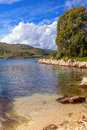 Scenic kassiopi on corfu view of a picturesque cove the peninsula greece Royalty Free Stock Image