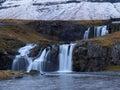 Scenic Kirkjufellsfoss waterfall in early winter, Snaefellsness, Iceland