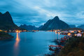 Scenic landscape on Lofoten islands with typical red fishing hut near mountains Royalty Free Stock Photo