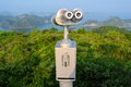 Scenic lookout binoculars vietnamese island cat ba coin operated telescope at a on the overlooking karst limestone rock islands in Royalty Free Stock Photography