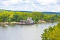 Scenic midwest view with riverboat a of the illinois river in illinois usa cloudy sky and Stock Image
