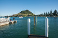 Scenic Mount maunganui with fishers on pier. Stock Photo