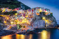 Scenic night view of colorful village manarola in cinque terre italy Stock Photo