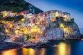 Scenic night view of colorful village Manarola in Cinque Terre Royalty Free Stock Photo