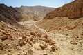 Scenic path descending into the desert valley israel shekhoret canyon near eilat Stock Photo