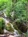 Scenic plitvice national park a calm and tranquil beautiful path at the lake Stock Photos