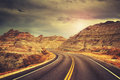 Scenic road at sunset, color toned picture. Royalty Free Stock Photo