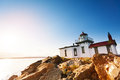 Scenic rock formations with West Point Lighthouse Royalty Free Stock Photo