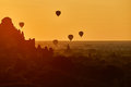 Scenic sunrise with many hot air balloons above Bagan in Myanmar