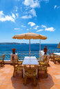 Scenic terrace in the mediterranean sea with tables and chairs Stock Photos