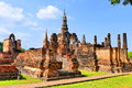 Scenic View Ancient Buddhist Temple Complex Ruins of Wat Mahathat in The Sukhothai Historical Park, Thailand in Summer Royalty Free Stock Photo