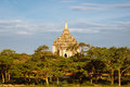 Scenic view of beautiful ancient temple at sunset bagan behind trees myanmar Royalty Free Stock Photography