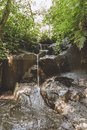 scenic view of beautiful Kanto Lampo Waterfall, green plants and rocks, Royalty Free Stock Photo