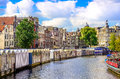 Scenic view of canal in Amsterdam at flower market Royalty Free Stock Photo