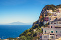 Scenic view of colorful houses on Capri island with Vesuvio background Royalty Free Stock Photo