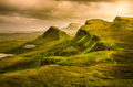 Scenic view of quiraing mountains sunset with dramatic sky scot in scottish highlands isle skye united kingdom Royalty Free Stock Photo