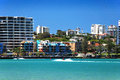 Scenic View Of Sea By City Buildings On Golden Beach Royalty Free Stock Photo