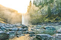 Scenic view of Snoqualmie falls with golden fog when sunrise in the morning. Royalty Free Stock Photo