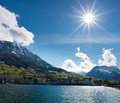 Scenic view sunshine over lake lucerne buochs village stanserhorn buochserhorn mountains background nidwalden switzerland Stock Photo