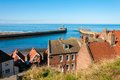 Scenic view of whitby city in autumn sunny day s attraction as a tourist destination is enhanced by its association with Stock Image