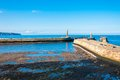 Scenic view of whitby pier in autumn sunny day s attraction as a tourist destination is enhanced by its association with Stock Photography