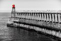 Scenic view of whitby pier in autumn sunny day s attraction as a tourist destination is enhanced by its association with Royalty Free Stock Image
