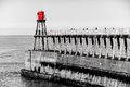 Scenic view of whitby pier in autumn sunny day s attraction as a tourist destination is enhanced by its association with Royalty Free Stock Photos
