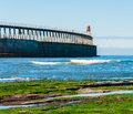 Scenic view of whitby pier in autumn sunny day s attraction as a tourist destination is enhanced by its association with Royalty Free Stock Photography