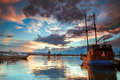 Scenic view of yachts and boat at dramatic sunset with cloudscape background Royalty Free Stock Images