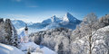 Scenic winter landscape in the Alps with church Royalty Free Stock Photo