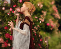 The scent of roses a lady in medieval garb smelling a rose Royalty Free Stock Image